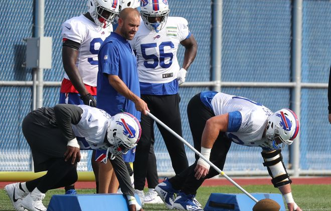 Buffalo Bills defensive line coach Bill Teerlinck works with Harrison Phillips and Jerry Hughes during a training camp session. (James P. McCoy/Buffalo News)