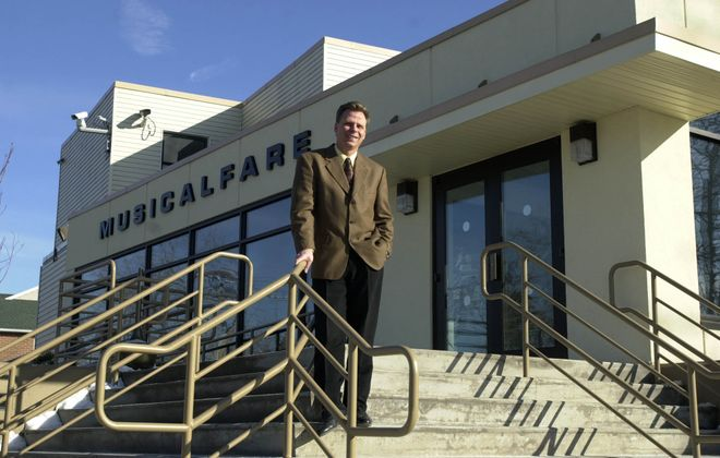 Randall Kramer stands outside MusicalFare Theatre on the Daemen College campus in this file photo. MusicalFare has made its home at Daemen since 1991. (Mark Mulville/Buffalo News file photo)