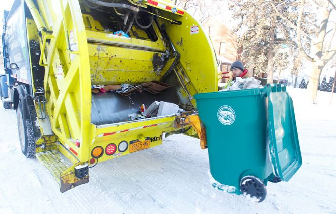 John Schmidtz empties a recycling tote on a  Modern Corp recycling truck at curbside pickup in Niagara Falls on Jan. 13, 2015.   (File photo/John Hickey/Buffalo News)