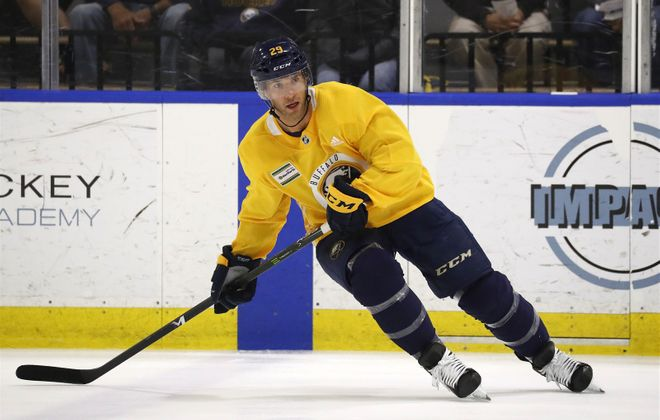 Jason Pominville looks for the puck during a training camp workout in HarborCenter. (Mark Mulville/Buffalo News)