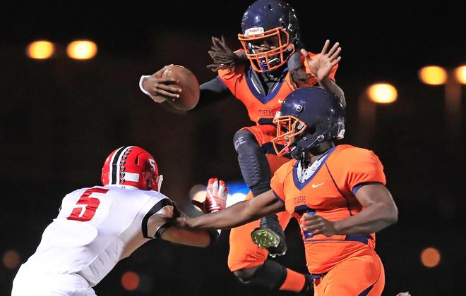 D'Jae Perry takes to the air during a rushing attempt for Bennett during its win over Lancaster on Thursday night at All-High Stadium. (Harry Scull Jr./Buffalo News)