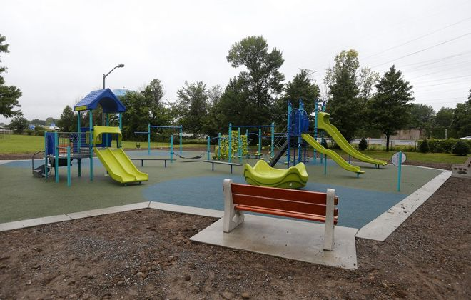 The new playground in Amherst's West Royal Park, which reopened thanks to a $188,000 investment and to the neighbors who installed the equipment.  (Mark Mulville/Buffalo News)