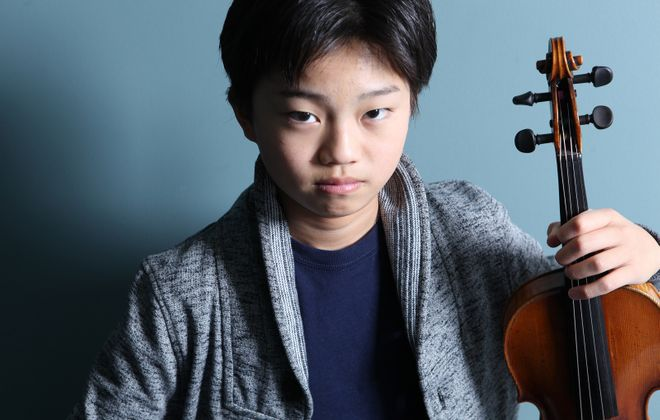 Ray Ushikubo, only 17, wowed the crowd at Kleinhans Music Hall when he played both violin and piano with the Buffalo Philharmonic Orchestra. (Jeff Fasano Photography)