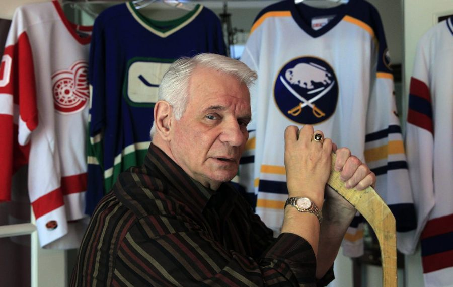 Former Buffalo Sabres defenseman Mike Robitaille, pictured in his home in 2016, has joined MJ Peterson. (Harry Scull Jr./Buffalo News)