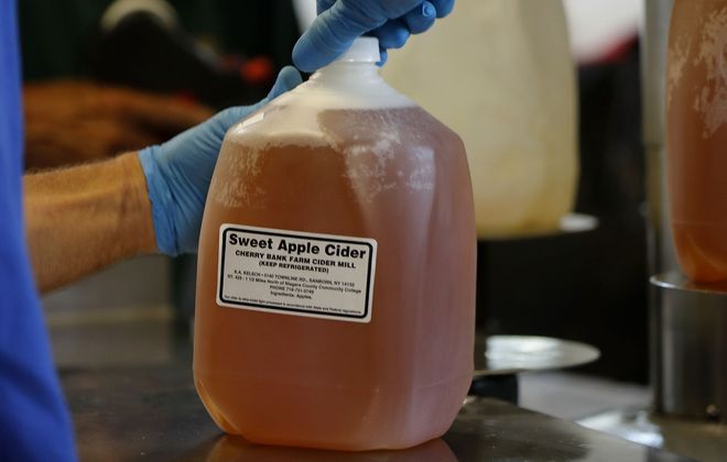 "Of Cherry Bank Farm's apple cider, Fran Kelsch says, ""If we were a bigger company and had advertising, we'd say, 'Our cider is like drinking your apple' – it's got that fresh flavor."" (Mark Mulville/Buffalo News)"