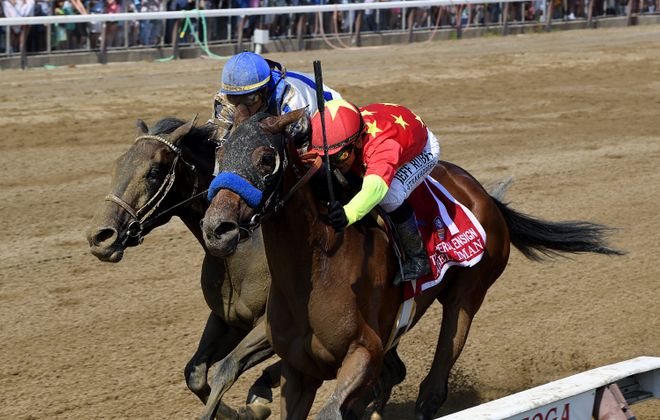 Abel Tasman holds off Elate in the Personal Ensign at the Spa. Photo Credit: Chelsea Durand/NYRA