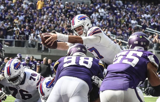 Bills quarterback Josh Allen (17) scores a touchdown on a quarterback sneak in the second quarter at U.S. Bank Stadium on Sunday.	(James P. McCoy/Buffalo News)