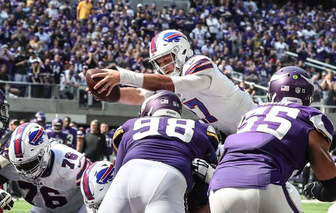 Bills quarterback Josh Allen scores a touchdown on a quarterback sneak in the second quarter at U.S. Bank Stadium. (James P. McCoy/Buffalo News)