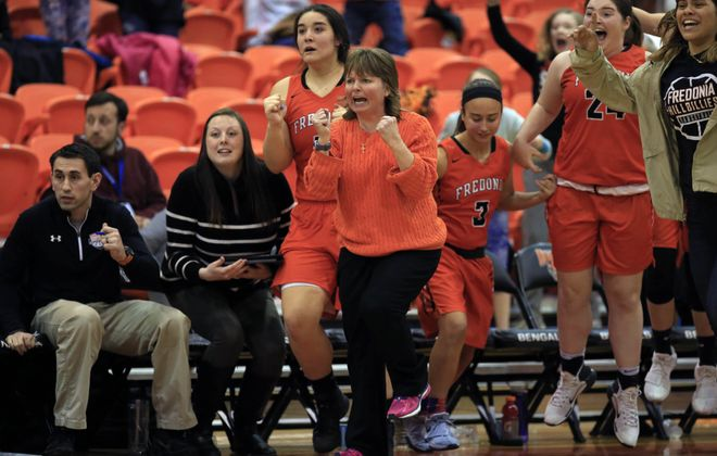 Fredonia coach Carol Zirkle celebrates a victory over Southwestern for the Section VI Class B championship at the Buffalo State Sports Arena last season. (Harry Scull Jr./News file photo)