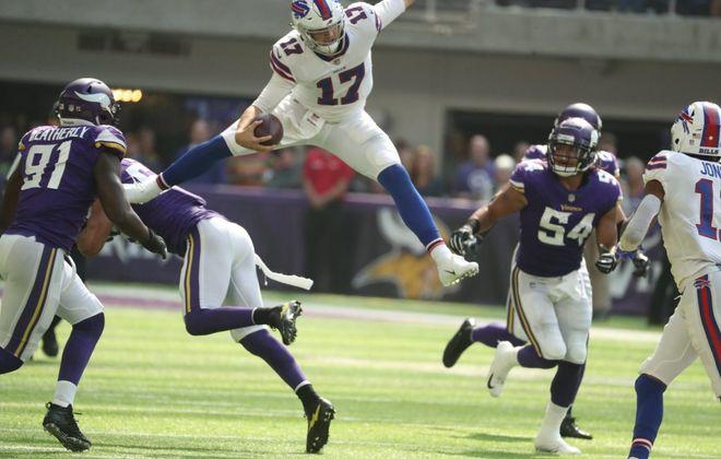Bills quarterback Josh Allen hurdles Minnesota Vikings linebacker Anthony Barr. (James P. McCoy/News file photo)