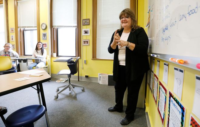 Teacher Pamela Rohring works with students in her classroom at St. Mary's School for the Deaf. (Derek Gee/Buffalo News)