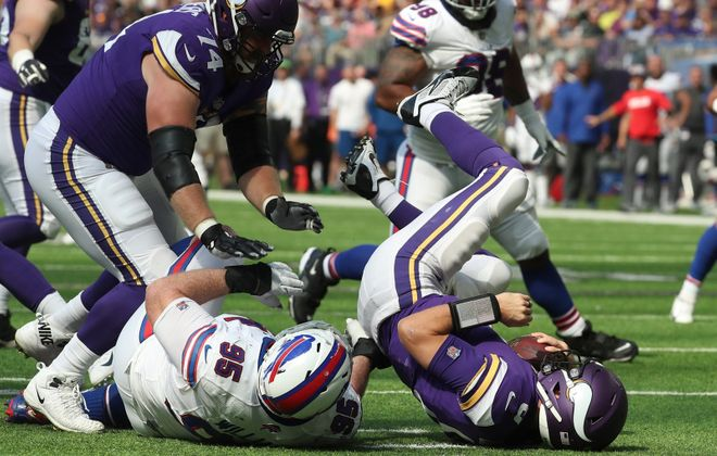 Bills defensive tackle Kyle Williams (95) sacks Minnesota Vikings quarterback Kirk Cousins (8) in the second quarter. Cousins did not, in fact, like that.(James P. McCoy/Buffalo News)