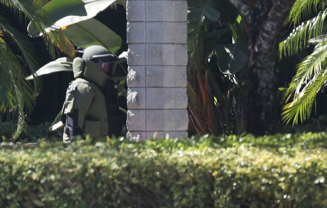 A member of the Broward Sheriff's Office bomb squad is seen as he prepares to enter a building in Sunrise, Fla., where Rep. Debbie Wasserman Schultz (D-FL) has an office, to investigate a suspicious package Wednesday. (Getty Images)