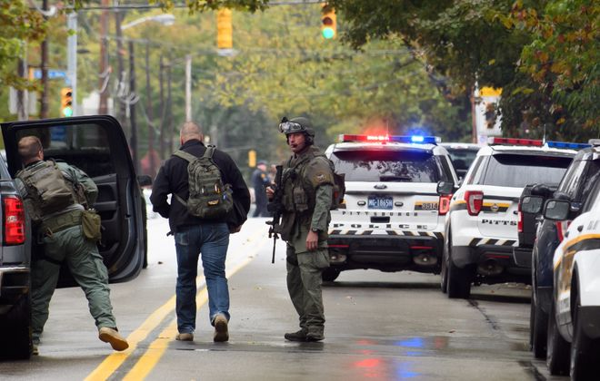 Police respond to the site of a mass shooting at the Tree of Life Synagogue in the Squirrel Hill neighborhood of Pittsburgh Saturday.   (Getty Images)