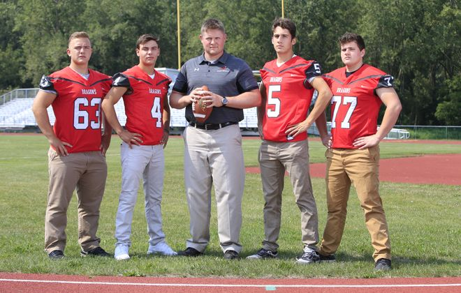 Maple Grove coach Justin Hanft (center) with (from left), DJ. Brown, Easton Tanner, Carson Crist and Alex Duncanson. (Harry Scull Jr./Buffalo News)