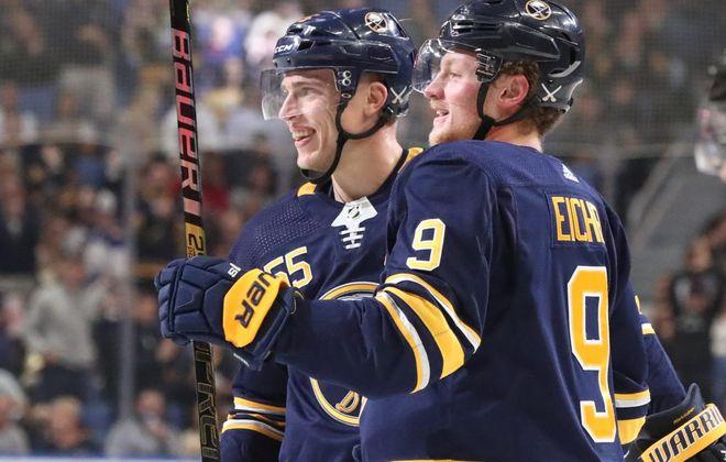 Jack Eichel and Rasmus Ristolainen, right. (James P. McCoy/News file photo)