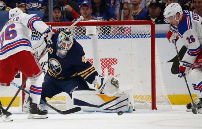 Buffalo Sabres goalie Carter Hutton makes one of his 43 saves Saturday night against the New York Rangers. (Derek Gee/Buffalo News)