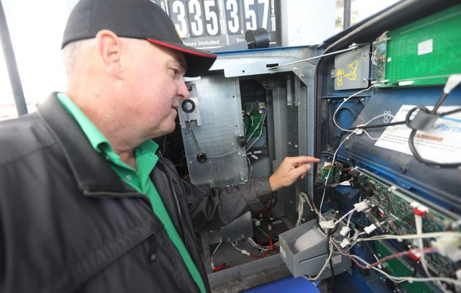 Greg Reusch, an inspector with the Erie County Division of Weights and Measures, showed last fall how Bluetooth credit card skimming devices can be attached to older gas pumps. Erie County Executive Mark C. Poloncarz wants to make changes to the government's consumer protection operations. (John Hickey/News file photo)