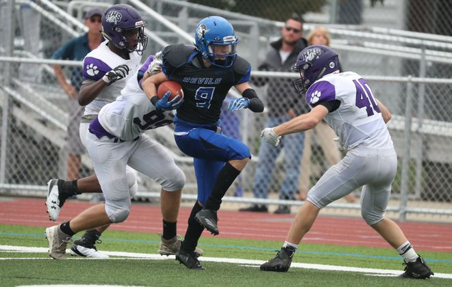 Kenmore West's Cameron Crosier rushes past Hamburg's Jack Migliore for a touchdown two weeks ago at Crosby Field. That was a sign of things to come as last weekend against Kenmore East, he set three school records in a win over the Bulldogs. (James P. McCoy/News file photo)