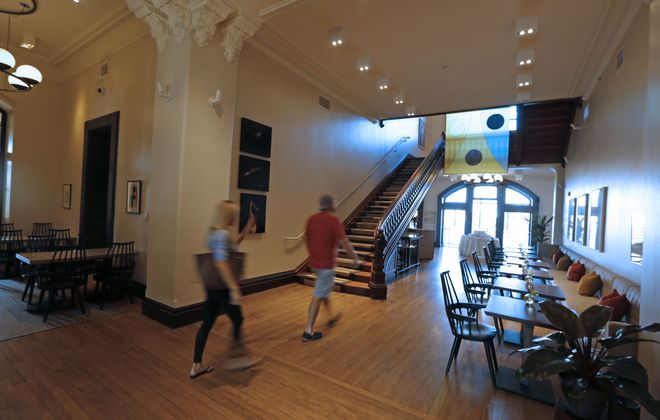 The main lobby of the spacious Hotel Henry welcomes visitors to what has become a popular destination for business and social events as well as local 'staycations' on the historic Richardson Olmsted Campus. (Robert Kirkham/Buffalo News)