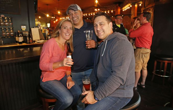 Beth Boussag of Kenmore, left, Dave Delvalle of Kenmore, center, and Remy Piazza,of Amherst enjoy drinks at The Jake in Kenmore. (Robert Kirkham/Buffalo News)
