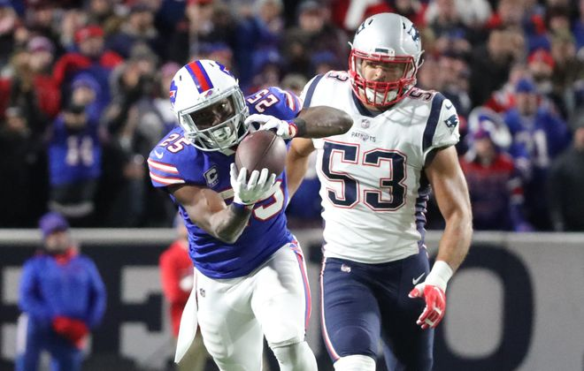 Bills running back LeSean McCoy catches a pass for a first down against Patriots linebacker Kyle Van Noy in the first quarter at New Era Field in Orchard Park on Monday, Oct. 29, 2018. (James P. McCoy/Buffalo News)