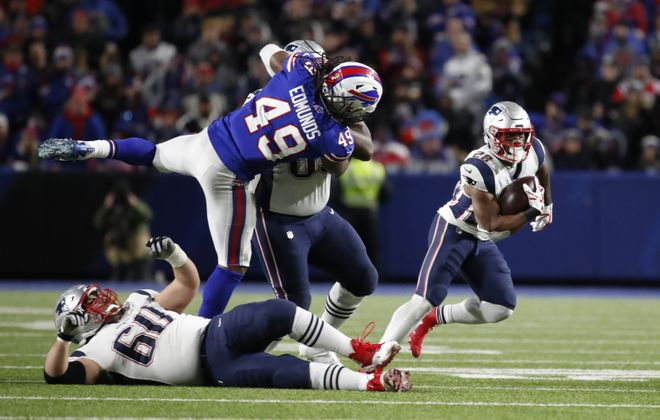 Buffalo Bills linebacker Tremaine Edmunds cannot get to New England Patriots running back James White. (Harry Scull Jr./Buffalo News)