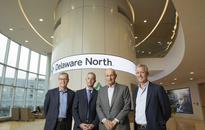 The Jacobs family, from left: co-CEO Jerry Jacobs Jr.; Charlie Jacobs, who is CEO of the company's Boston Holdings; Chairman Jeremy Jacobs; and co-CEO Lou Jacobs, in the Delaware North headquarters in Buffalo in 2018. (Derek Gee/News file photo)