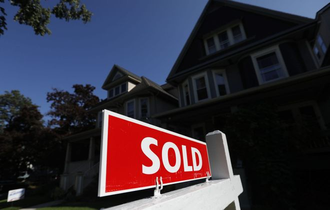 Home sale closings are more complicated under social distancing rules. (Derek Gee/News file photo)