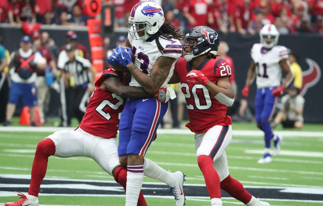 Bills wide receiver Kelvin Benjamin catches a pass for a first down in front of Houston Texans cornerback Johnathan Joseph in the third quarter at NRG Stadium in Houston on Sunday, Oct. 14, 2018. (James P. McCoy/Buffalo News)