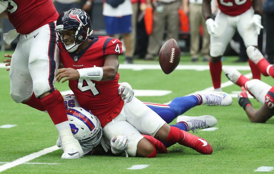 Bills defensive end Jerry Hughes puts a hit on Texans quarterback Deshaun Watson. (James P. McCoy/Buffalo News)