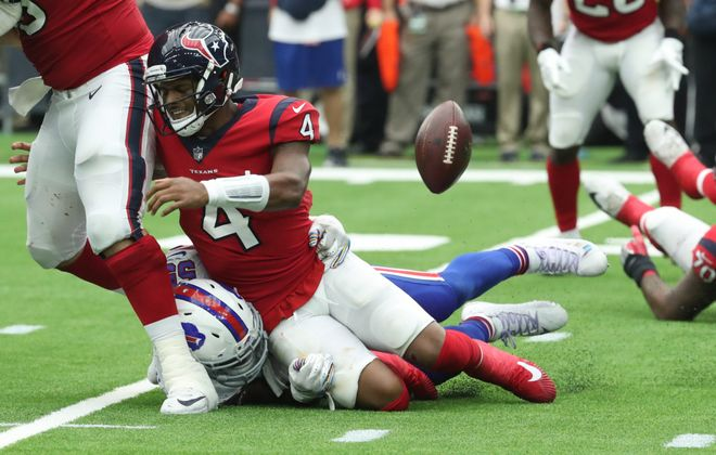 Bills defensive end Jerry Hughes puts a hit on Texans quarterback Deshaun Watson. (James P. McCoy/Buffalo News)