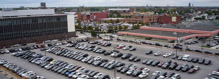 The parking lot south of Clinton Street between Oak and Ellicott streets where a high-rise building and grocery store have been proposed. (Derek Gee/News file photo)