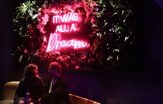 Sing pop punk hits at live band karaoke on Friday nights at Rec Room, then snap a photo under its instafamous neon sign. (Sharon Cantillon/Buffalo News file photo)
