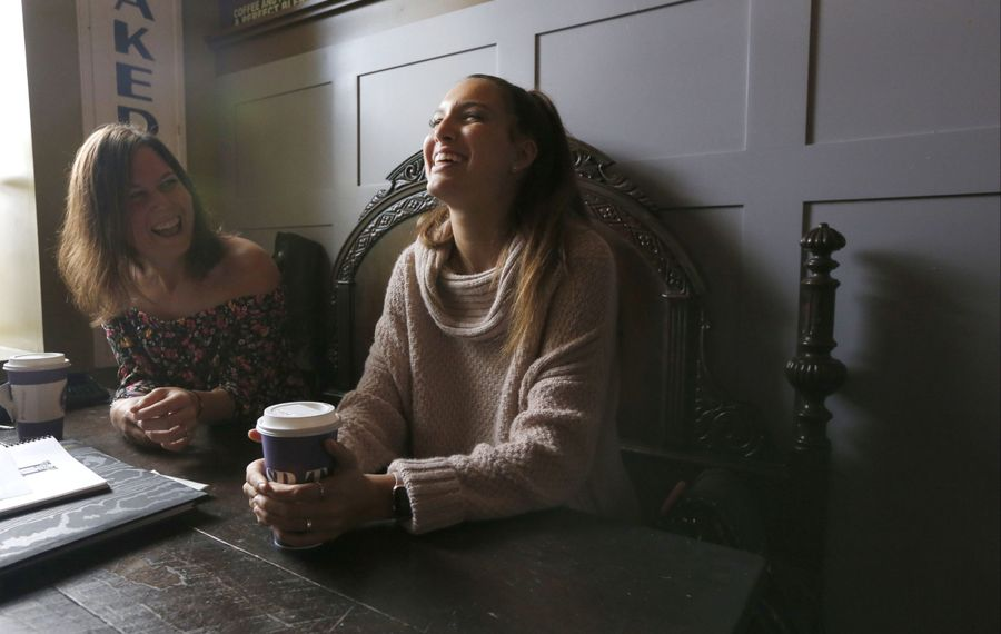 """Emma Ballowe, right, longtime girlfriend of Conor Long, remembers some of what she called his """"goofball"""" moments as his sister Meghan, left, listens. (Robert Kirkham/Buffalo News)"""