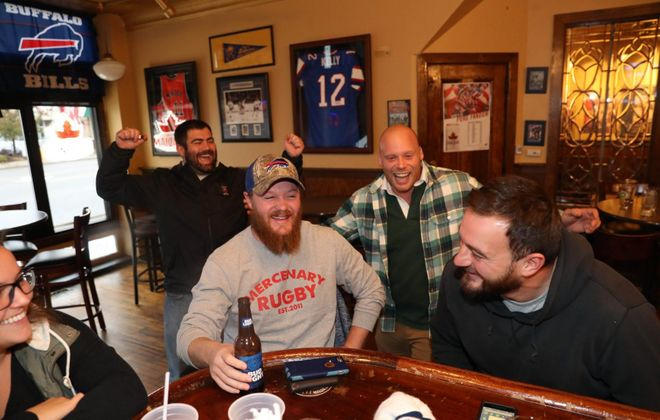 """A group of friends share some laughs while hanging out at KO Bar & Grill. From left are Liz Flowers, Alex Brussard, Collin DeGuehery, Clarence Picard and Jeff """"Fluff"""" Wells. (Sharon Cantillon/Buffalo News)"""