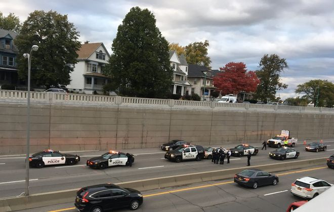 Police charged three people after a chase that ended on the Kensington Expressway on Tuesday. (Patrick Lakamp/Buffalo News)