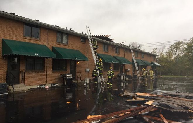 A funnel cloud ripped the roof off a condominium complex in West Seneca, police said. (Photo courtesy of Seneca Hose Company #1)
