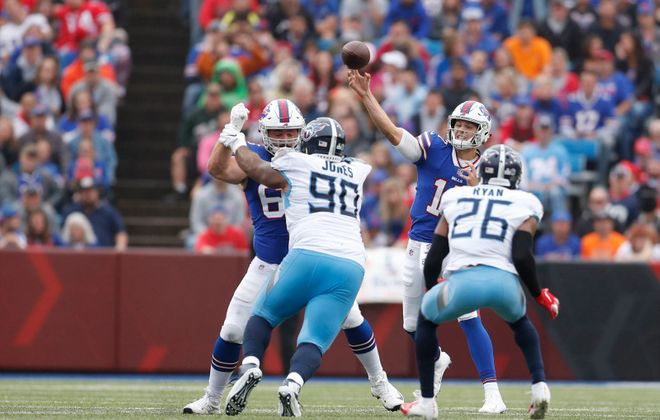 Bills' Josh Allen executed four bootleg play-action passes and twice threw out of moving pockets. (Mark Mulville/Buffalo News)