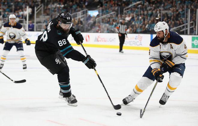 Sabres defenseman Zach Bogosian defends against San Jose's Brent Burns (Getty Images).