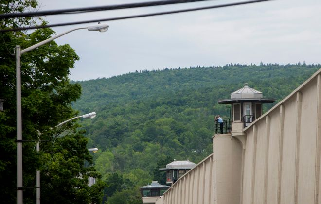 A guard looks out from a tower at the Clinton Correctional Facility in Dannemora, where two prisoners escaped in 2015. Richard Matt was fatally shot by law enforcement officers and David Sweat was taken into custody. (Getty Images)