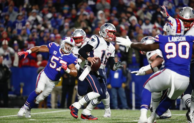The Buffalo Bills' Lorenzo Alexander (57) chases down Patriots quarterback Tom Brady. (Harry Scull Jr./News file photo)
