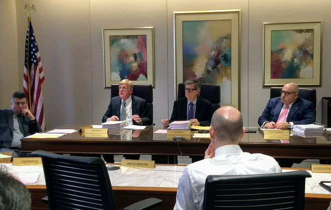 Erie County Water Authority commissioners review report outlining past failures of the authority to properly handle FOIL requests. (Sandra Tan/Buffalo News)