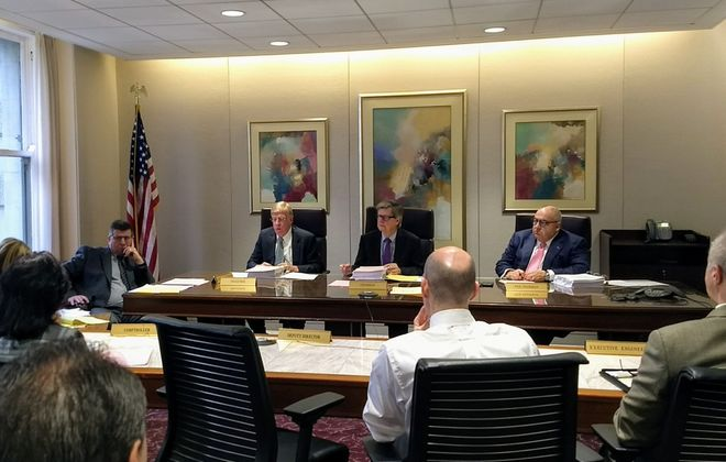 Erie County Water Authority Commissioner E. Thomas Jones, left of center, has resigned after 1 1/2 years in the position. (Sandra Tan/Buffalo News)