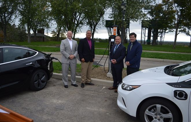 Erie County Executive Mark C. Poloncarz, right, is joined by (L-R) Craig Jackson of Clean Communities of WNY, Tony Hazzan of NYSERDA, and Public Works Commissioner Bill Geary at Chestnut Ridge Park to unveil the park's new dual port electric vehicle charging station, located near the casino. (Photo courtesy of Erie County)
