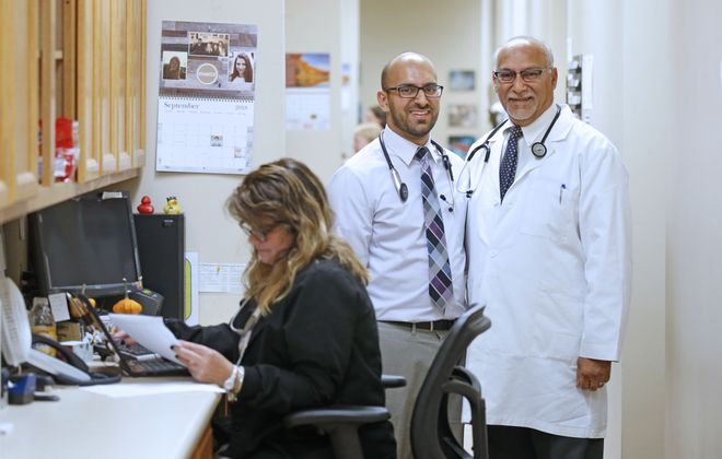 Dr. Adnaan Sheriff, center, and his father Dr. Fuad Sheriff, are embracing changes in medicine but would like to see the health care system work more efficiently for both patients and primary care doctors like themselves.  (Robert Kirkham/Buffalo News)
