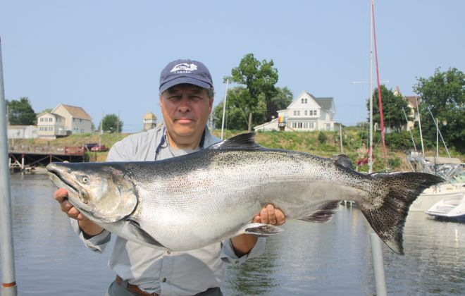Joe Yaeger of Amherst shows off a 32-pound king that won the 2017 LOC Summer Derby. The 2018 winner was under 29 pounds. (Courtesy photo)