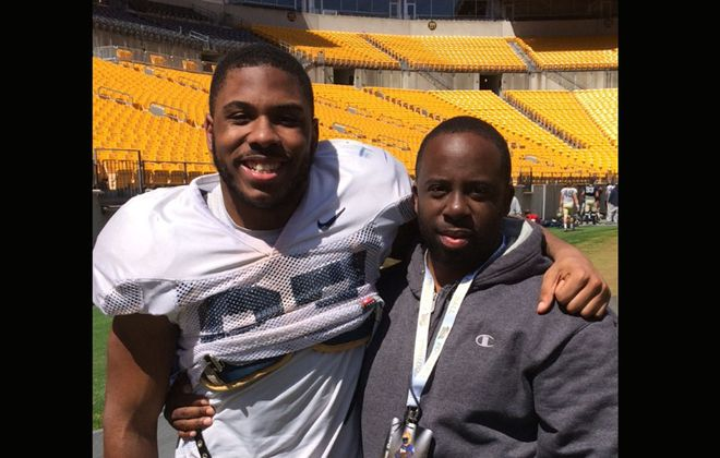 Qadree Ollison, left, and  his late brother Rome Harris at the opening game of Pitt's 2017 season. It was the last time Ollison saw his brother, who was fatally shotOct. 14, 2017, in Niagara Falls.(Courtesy of Wayne Ollison)