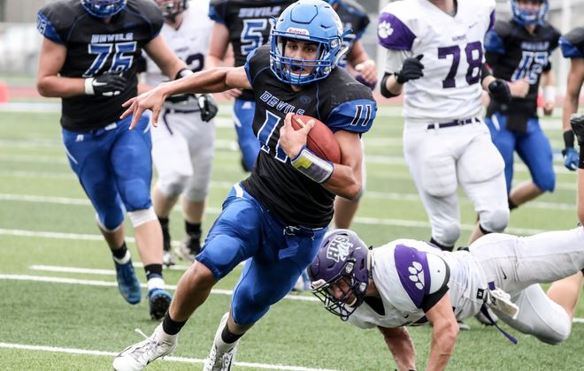 Joseph Stewart rushed for 109 yards and a touchdown for Kenmore West in its playoff-clinching victory over Hamburg on Saturday at Crosby Field. (James P. McCoy/Buffalo News)