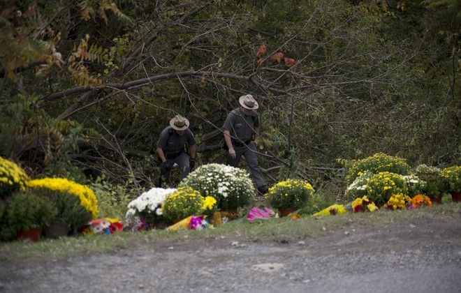 State police officers at the site of an October 2018 limousine crash that left 20 dead in Schoharie. (Kyle Adams/New York Times)